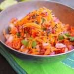 Grated carrot , tomato, onion salad with chia seeds